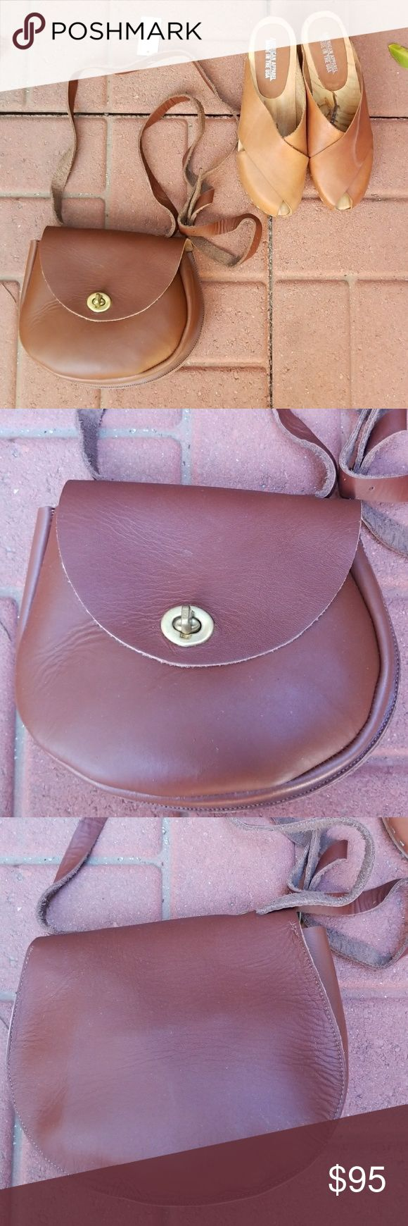 American Apparel leather Crossbody purse NWT Brand new with tag attached American Apparel brown leather Crossbody purse. Fits a lot and very useful.  Hard to find in this brand NEW condition. Amazing quality leather will last very long!! No trades American Apparel Bags Crossbody Bags