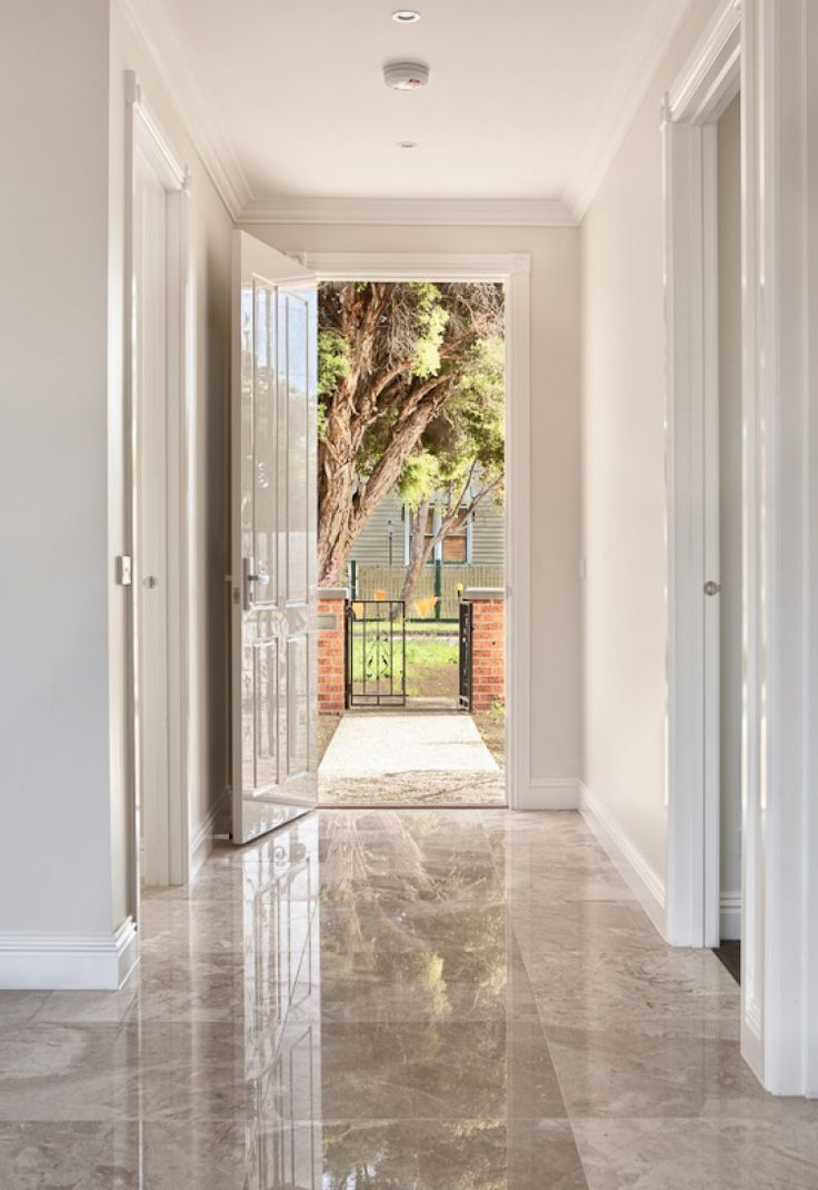 Carmen Beige Marble Polished Tiles Are Used As On The Floors In The Entrance And Kitchen Eve House Flooring Floor Tile Design Tiled Hallway