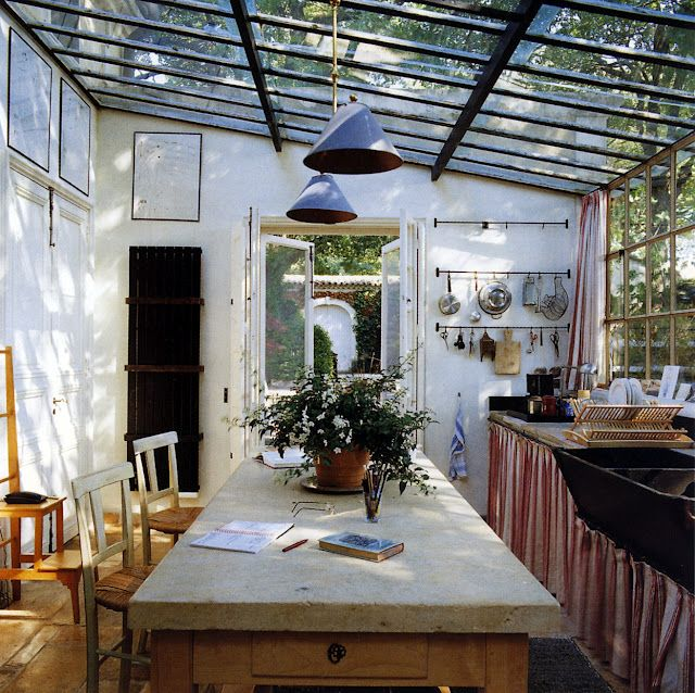 Fantastic kitchen with industrial ceiling and pendants.  Rustic table and chairs.  Skirt around counters.