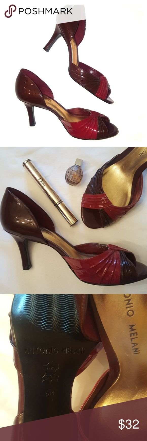 Gorgeous Antonio Milani D'orsay Pumps! Like new. A couple of miniscule flaws, pictured. I needed my reading glasses to see them. Lol! Burgundy, garnet, oxblood.  100% leather (patent). Just gorgeous! Other items pictured are not included in the purchase of this item. Some are listed separately for sale. ANTONIO MELANI Shoes Heels