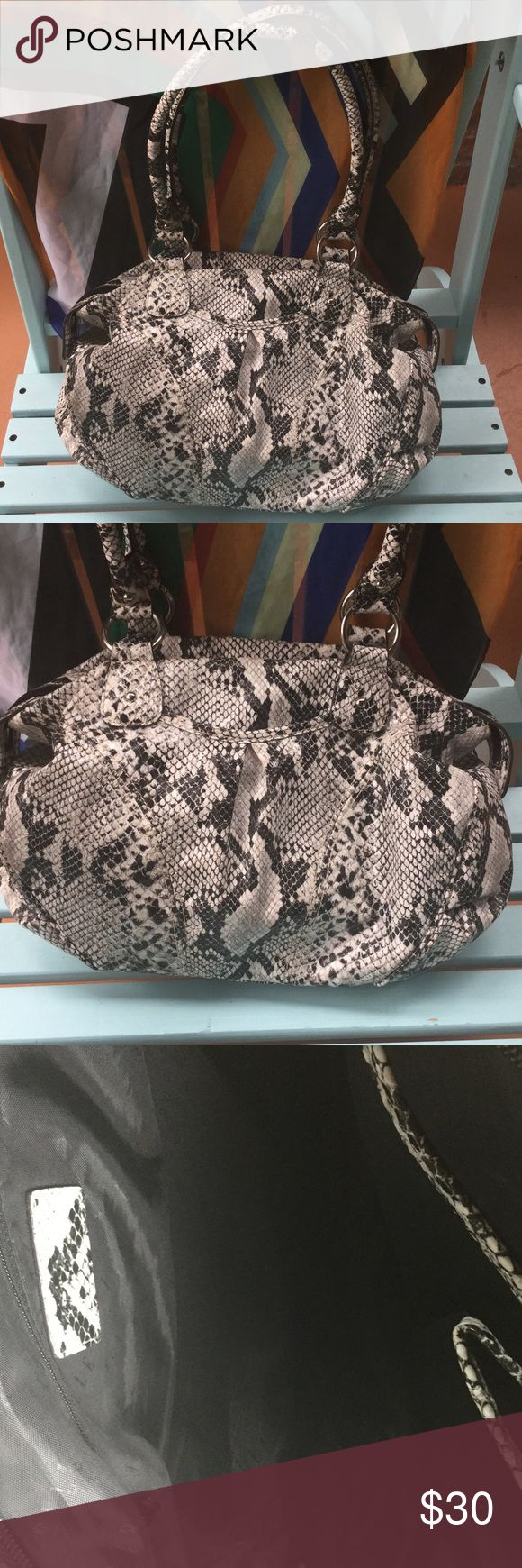 vinyl snake print bag ELLE snake print vinyl bag.  Interior has one zipper pocket and two open side pockets.  Bag dimensions are 13.5 inches x 10 inches x 4 inches.  11 inch handle drop.  EUC Elle Bags Shoulder Bags