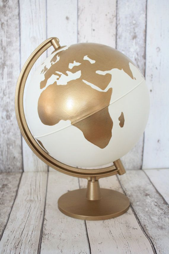 This listing is for an upcycled plastic globe. It has been hand painted with matt white and metalic gold colours - this means there are some visible