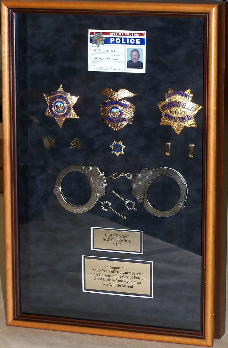 This police shadow box was a retirement gift and includes the badge, handcuffs…