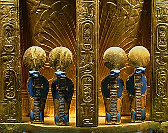 *THE REVERSE SIDE OF THE THRONE OF PHARAOH TUTANKHAMUN: with four golden uraeus cobra figures. Gold w/ lapis lazuli, Valley of the Kings, Thebes, 1347-37 B.C.E.)