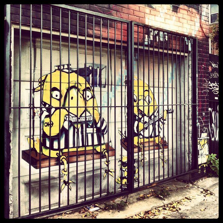 Two jail birds. Found these two behind bars. Street art Toronto. Graffiti art.