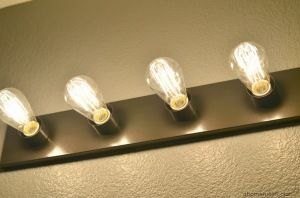 Edison bulbs to update rental light strips in the bathroom.  Cheap and easy renovation idea.