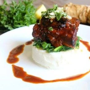 RED WINE BRAISED SHORT RIBS OVER MASHED POTATOES