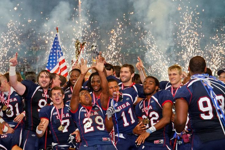 Members of USA Football team celebrate a championship win with wild gestures and fireworks in the background