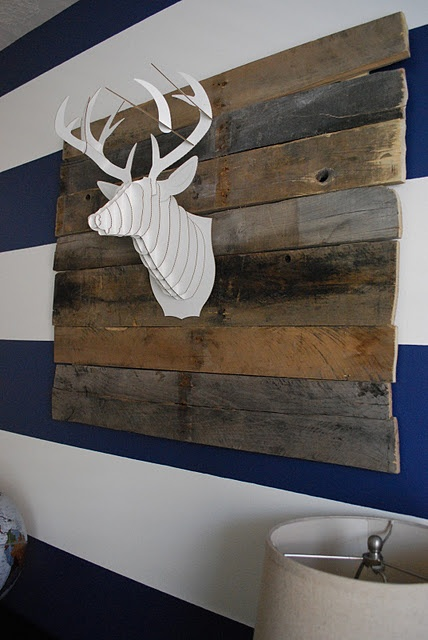Cardboard deer head mounted on upcycled pallet boards