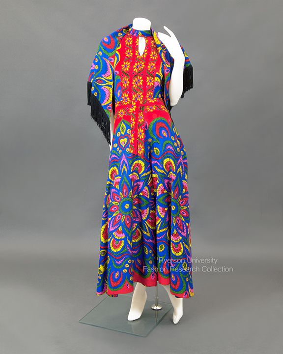 Multi-coloured floral knit jumpsuit with shawl and self-belt, c.1970s. Label: The House of Nu-Made Toronto, Canada. FRC1993.04.023 A+B+C