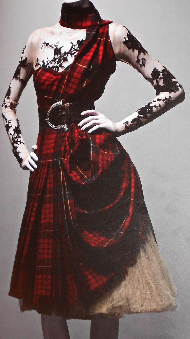 Dress of McQueen tartan, top of nude silk appliqued with black lace; underskirt of cream silk tulle