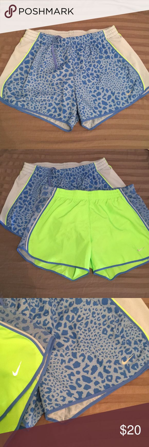 Nike Dry Fit Shorts ✨Bundle✨ One pair of neon green with blue cheetah mesh and one pair of blue cheetah with light blue mesh and neon green piping. These are barely worn, never really fit right... they have sat in my closet long enough ! Price is for both pair ! Please note the tiny stain on the back elastic of the green pair ! See pics ✨💕 Nike Shorts