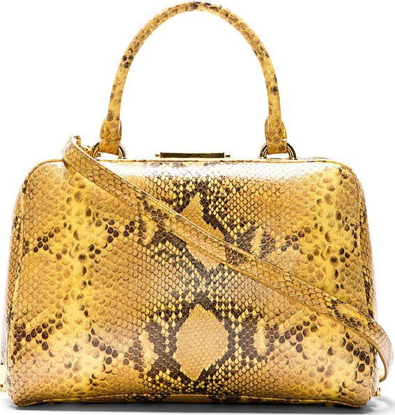 Yellow Snakeskin-Printed Leather Bag 51 by Simone Rocha. Structured retro top handle bag in yellow and brown snakeskin-printed leather. Gold-tone hardware. Hinge and logo-engraved push-lock closure at main compartment.  http://www.zocko.com/z/JJ6RB