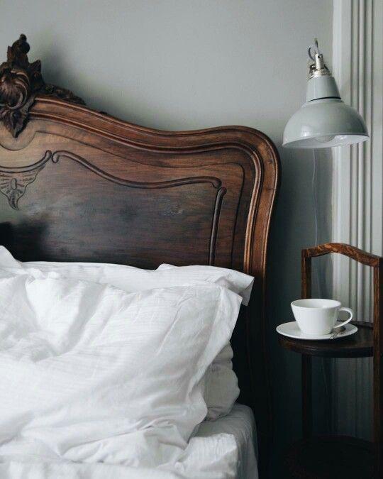 Gorgeous wooden headboard. Pretty bedroom details.