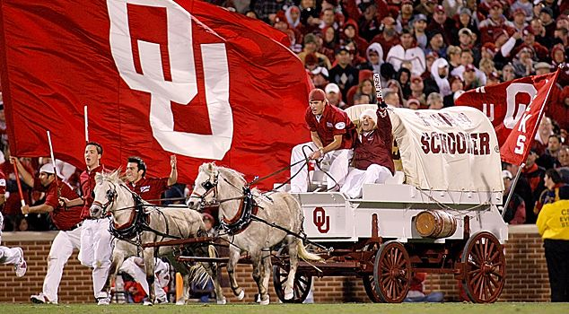 The Sooner Schooner is a conestoga (covered wagon) reminiscent of the mode of travel used by pioneers who settled Oklahoma Territory around the time of the 1889 Land Run.     Powered by matching white ponies named Boomer and Sooner, the Schooner races across Owen Field in a triumphant victory ride after every OU score.      Follow the link for more Oklahoma traditions.