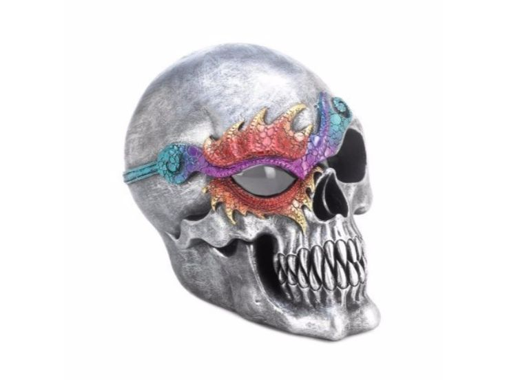 """This cool skull figurine features a silvery finish and a dazzling eye patch that will catch the attention of all who see it. The interior LED light makes one eye glow with spooky splendor. Two """"AA"""" batteries not included.  Item dimensions: 7.00"""" W x 6.50"""" H x 5.50"""" L Materials: Polyresin, Led Light"""