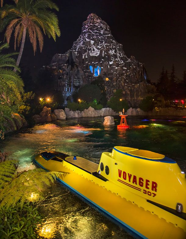 There are many photo opportunities at night around the Finding Nemo Submarine Voyage lagoon. From the reflections in the water to the lights on the submarines, they are all worth taking some extra time to enjoy on your way to find Nemo.