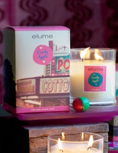 Elume A Moment in Time Candle – Candy Apple. Toffee apple aromatic candle    Wandering wide-eyed through the fair the delicious scent of green apple and sweet candy accompanies bright neon and flashy music to quicken the pulse. A fruit medley of pineapple, banana and orange on a sweet base of spicy nutmeg and almond perfectly sets the scene for festivity and adventure.