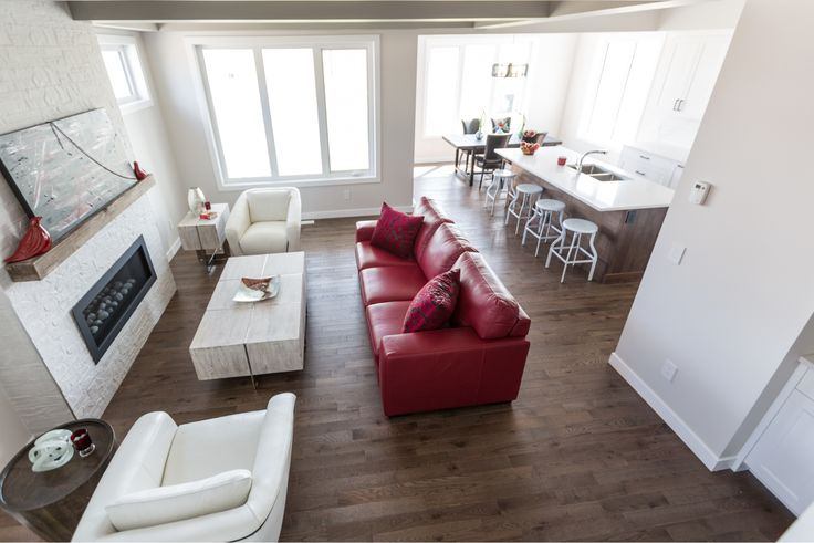 This modern living room features Lauzon's Sincero Red Oak flooring from our Authentik serie. This extremely durable wood offers rich brown color and distinctive grain. Photo by Lexis Homes for the Rosewood Show Home.