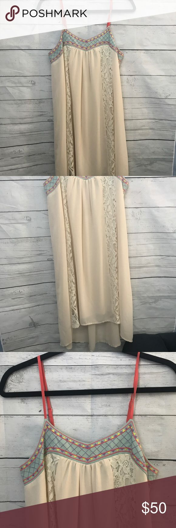 NWT Flying Tomato Cream Lace Dress New with tags dress! Cream color with lace inserts and a colorful top neckline area. Stitched design on top with adjustable spaghetti straps. Light of a high low style. Size small but can fit medium for sure! Offers are welcome. No trades Flying Tomato Dresses High Low