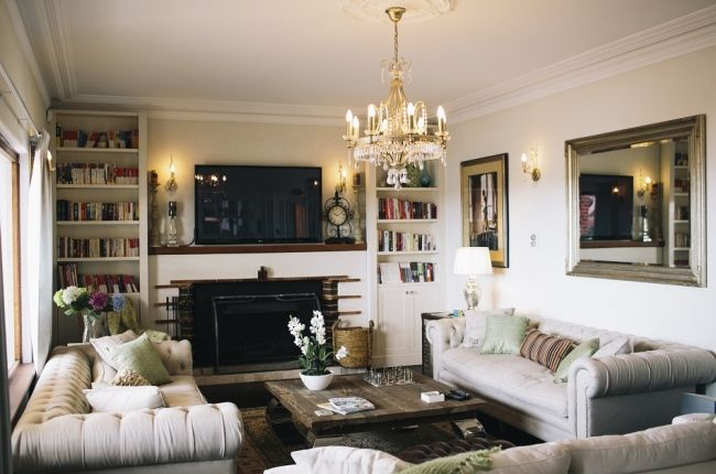 Love the two couches facing each other. TV is almost an afterthought in this pretty space.