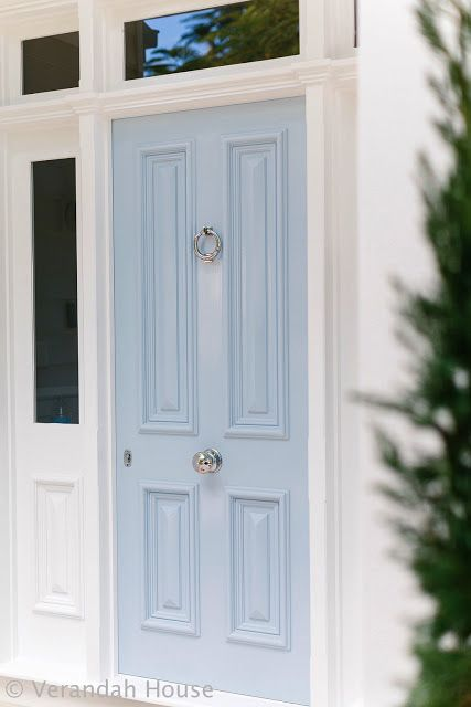 A White House With A Baby Blue Door & Shutters