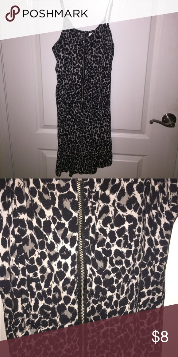 Cheetah Print Dress Black, white, and grey cheetah print dress. Zip up front center. Tight up top and flowy from waist Dresses Mini