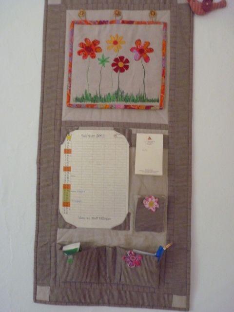Kalender-Utensilo mit wechselnden Monatsbildern
