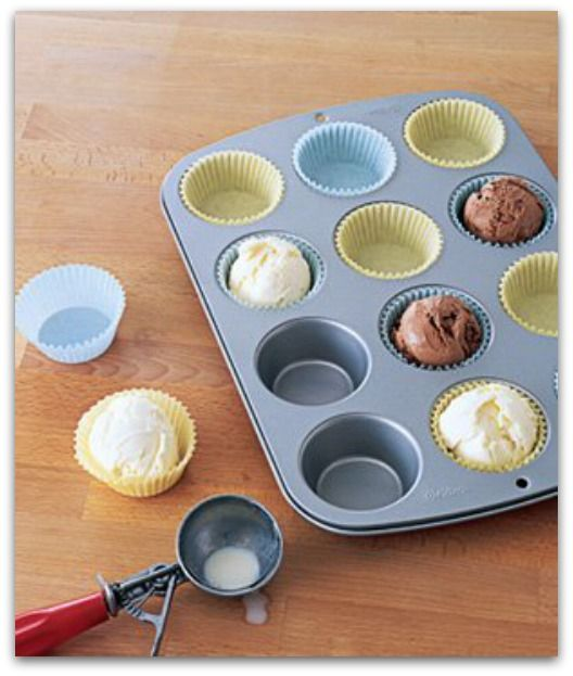 Great idea!  Scoop ice cream, place in cup cake liners, then put in freezer until ready to serve.
