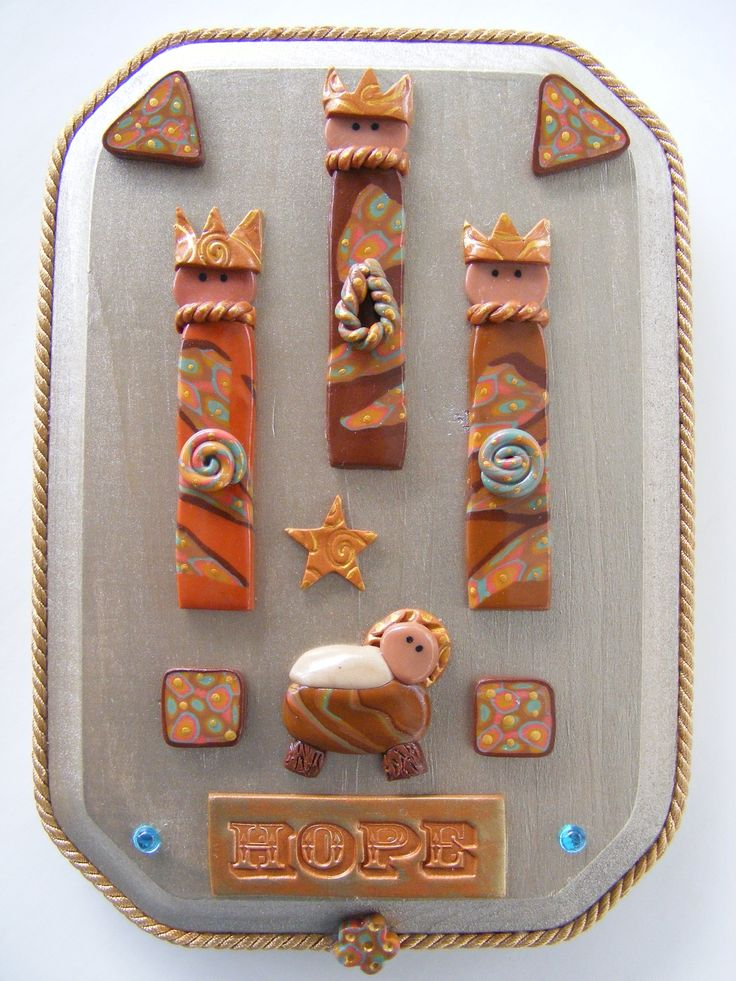 Medium plaque with Three Wise Men and baby Jesus.  Polymer clay on wood plaque