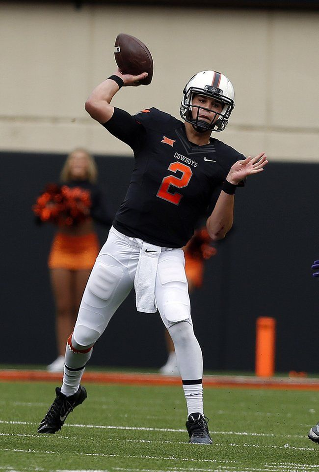 Oklahoma State's Mason Rudolph (2) makes a throw during a college football game between the Oklahoma State Cowboys (OSU) and the Kansas State Wildcats (KSU) at Boone Pickens Stadium in Stillwater, Okla., Saturday, Oct. 3, 2015. Photo by Sarah Phipps, The Oklahoman