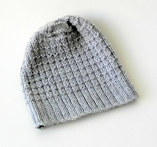 The hat is knit entirely in the round, starting with smaller needles for a tighter brim, then the body is knit on slightly larger needles. The stitch pattern yields a squishy and rather stretchy fabric, which is especially useful with children's hats! This is a good hat project for a beginner, all you need to know is how to knit and purl in the round and knit two stitches together.