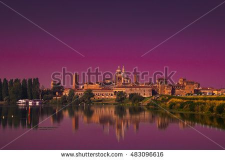 Panoramic view of  enchanted Mantua city at sunset reflecting on the Mincio #Mantova #City #Italy #Sunset #Mincio #Architecture #Medieval #Old #Castle #Fortress #Beauty #Urban #Panoramic #View