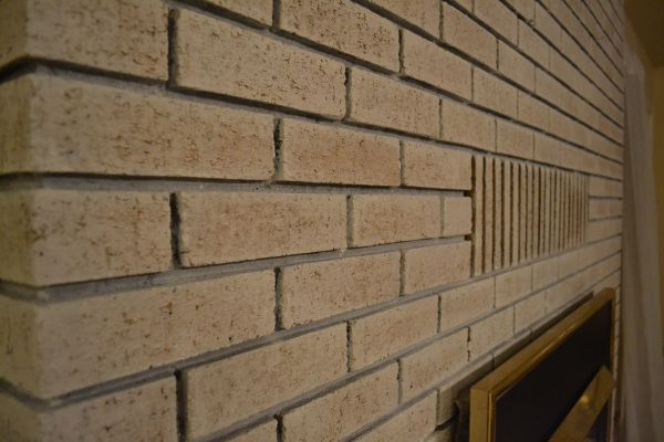 Whitewash Your Outdated Yellow Brick Fireplace Brick Fireplace Brick Fireplace Makeover Brick