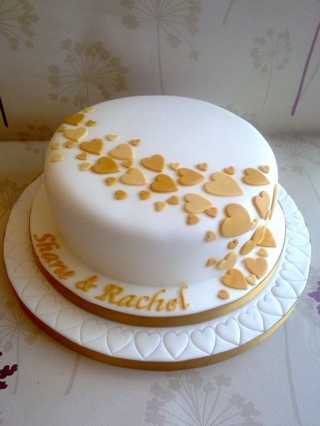 Love the hearts. Maybe in another colour on silver background http://weddingnya.com/beautifully-simple-one-tier-wedding-cake/