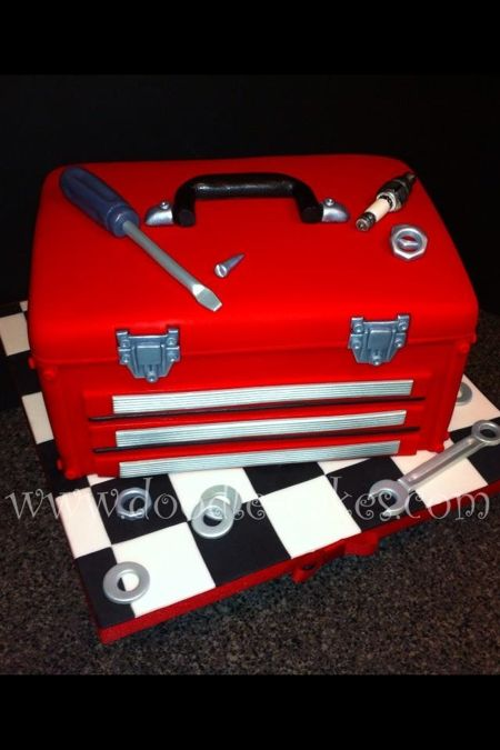 Toolbox cake. It doesn't look like a cake that's for sure. It just looks like a toolbox. What an awesome grooms cake for the tinkering guy!