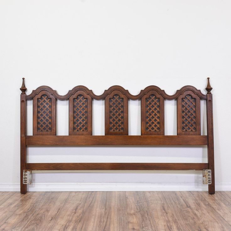 This king sized headboard is featured in a solid wood with a dark walnut finish. This large headboard is in great condition with latticework panels, carved finial columns and a curved top. Eye catching headboard perfect for accenting a wall! #traditional #beds #headboard #sandiegovintage #vintagefurniture