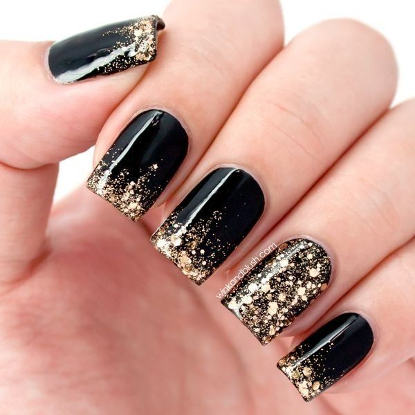 Black nail polish with gold glitters and sequins. Let that golden French tip stand out by adding gold embellishments instead of regular nail polish.