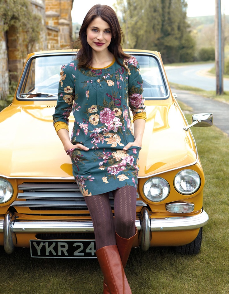 A daytime dress like this one with tights and boots is a nice choice for a date in a country pub.