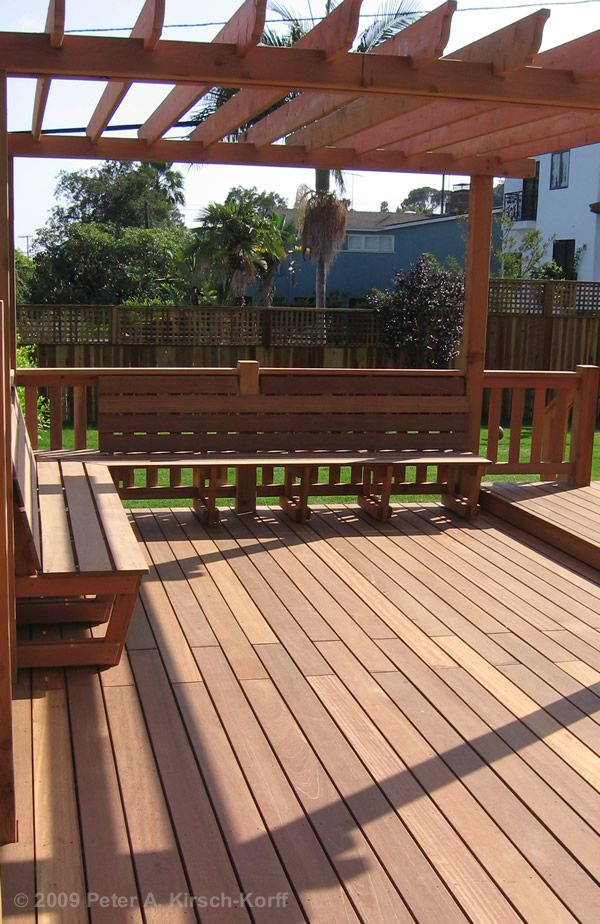 Pergola on deck with built-in seating - ours will kind of look like this, but with more seating and cushions on the seats for more comfort