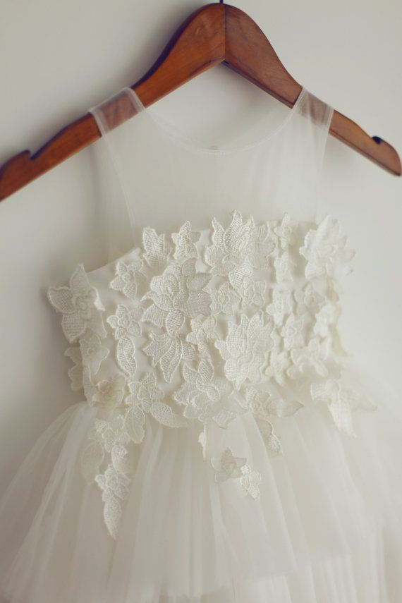 Sheer neckline made of tulle with lace appliques at the chest and slightly over the skirt Cupcake skirt made of tulle This dress can be made in
