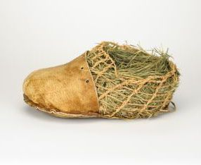 Otzi's shoes, the second oldest surviving pair in the world, are made from three different leathers, a net of linden tree twine, and insulated with hay.