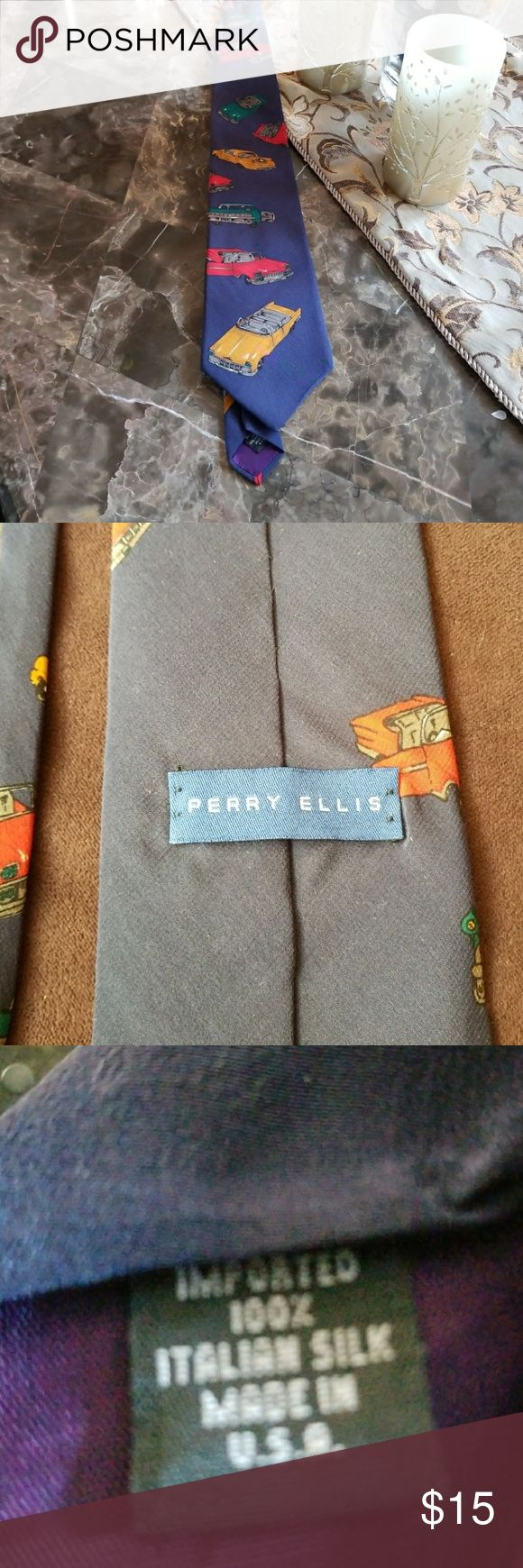 """Men's tie Perry Ellis  100% Italian Silk, pre loved men's blue tie with different  colored cars. When folded in half 29"""" long. If you like unique ties and not look like everybody else, this is the tie for you......A REAL CONVERSATION PIECE. Perry Ellis Other"""