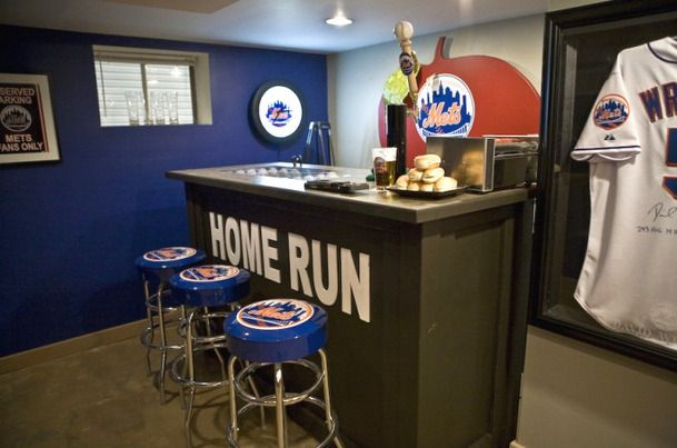 New York Mets Man Cave - check out the awesome display case, and the recreation of the Shea Stadium apple & home run sign. Well done!