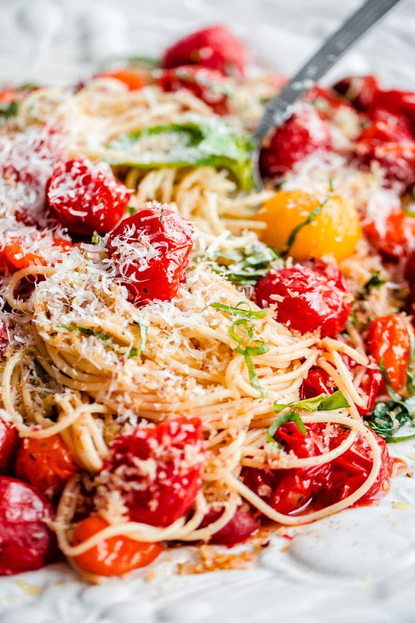 Spaghettini with Roasted Tomatoes, Basil, and Crispy Garlic Breadcrumbs. This dish can be thrown together in less than 30 minutes and is so flavor packed!