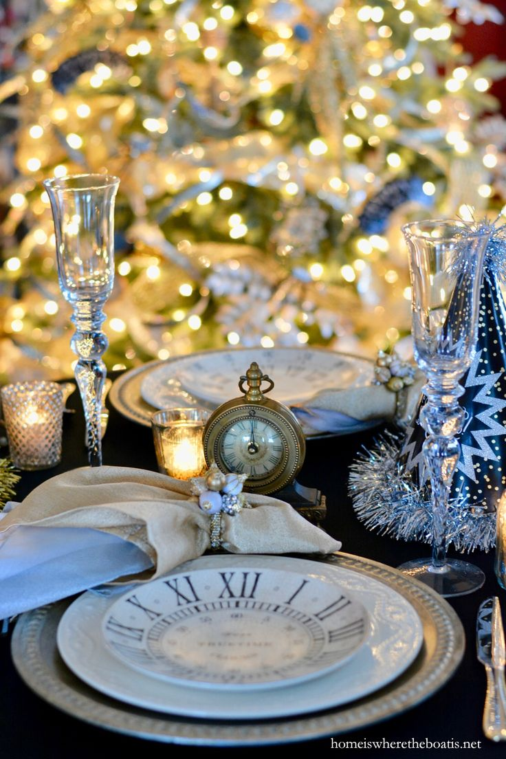 New Year's Eve table with clock plates, clocks and party horns and hats | homeiswheretheboatis.net #NewYearsEve #party #tablescape