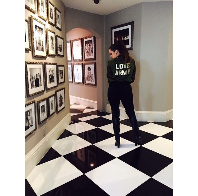 Hallway gallery of photos at Khloe Kardashian house