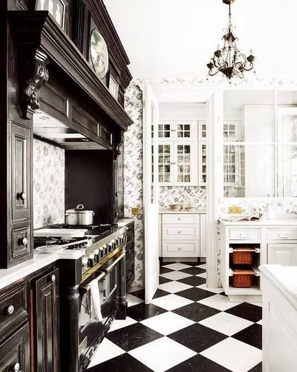 I have been in love with the idea of a french provincial kitchen with the traditional checkerboard floors....this is close, but not quite there!