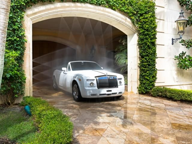 Car Being Built Garage : A car wash is built into the exit of port cochere so