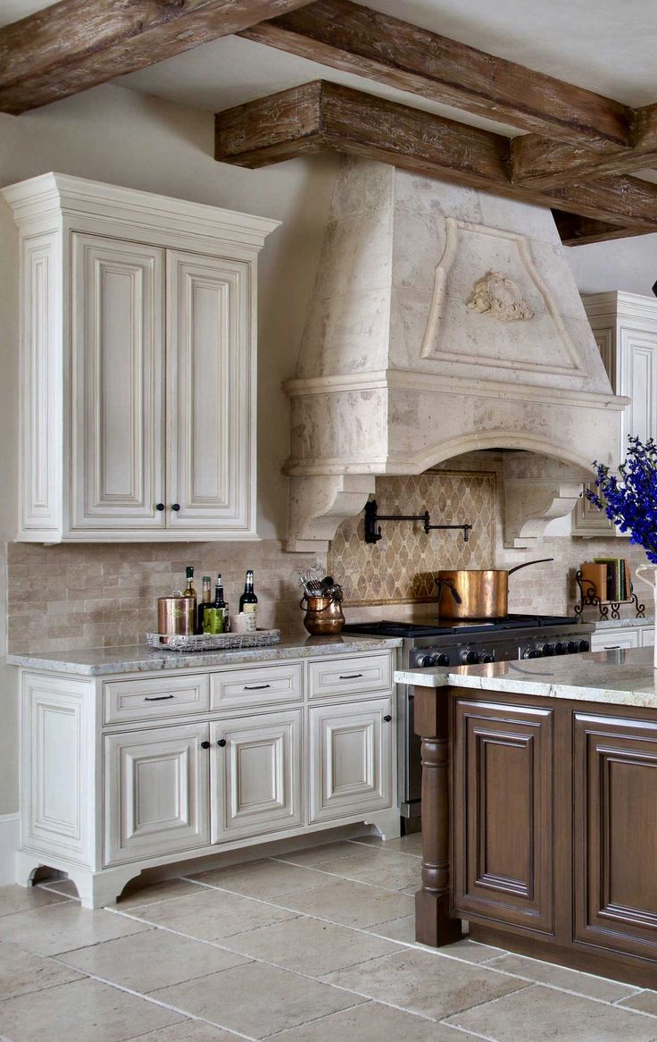 i actually like the hood, the backsplash tile and the beams, everything else, nahhhh